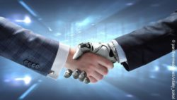 Photo: human hand holding a robot hand; copyright: panthermedia.net/vitaliy_sokol