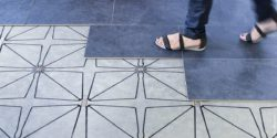 Photo: Woman walking on floor with sensor underlay; copyright: Future-Shape GmbH