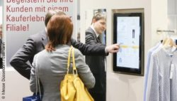 Photo: Digital shelf in the form of a touch screen in the clothing trade; copyright: Messe Düsseldorf / ctillmann
