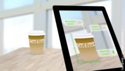Photo: Tablet showing additional information about a to go coffee cup; copyright: panthermedia.net / BeeBright