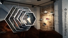Photo: shoes on a octagonal shelf at adidas store in London