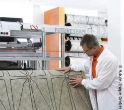 Photo: Engineer examining the underlay for the SensFloor System. Copyright: Future-Shape GmbH