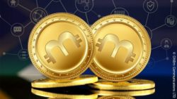 Photo: Golden coins with currency symbol 'm' on them; copyright: ONEm Communications LTD